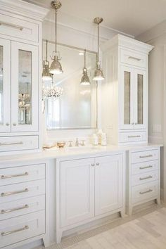 All white bathroom features an extra wide single vanity topped with white marble. All white bathroom features an extra wide single vanity topped with white marble under a polished . White Vanity Bathroom, Bathroom Vanity Cabinets, Vanity Sink, Small Bathroom, Bathroom Fixtures, Bathroom Built Ins, Plum Bathroom, Seashell Bathroom, Bathroom Vanity With Drawers