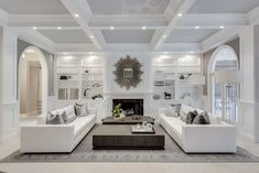 Restoration Hardware inspired white living room decor with modern white sofas, fireplace, and square coffee table. Beautiful all white living room furniture. I like the modern couches and the dark modern coffee table. Living Room White, Formal Living Rooms, Home Living Room, Living Room Designs, Small Living, Modern Living, Paris Living Rooms, Living Room Decor Elegant, Cozy Living