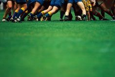 High-Res Stock Photography: Rugby Union players in scrum focus on…