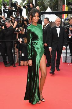 Liya Kebede showed a little leg in an emerald-green Haider Ackermann gown at The Unknown Girl's premiere. I...