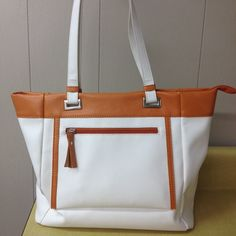 """Host pick 4/18 White purse, beautiful and roomy! White and tan Italian purse. This is a very roomy purse to carry all of your things, and then some! I carry my iPad, kindle reader, wallet, sunglasses, and still have room for more. Straps are about 10 1/2"""" drop, and the purse size is 15""""w x 12""""h x 5""""d. No scuff marks, no dirt, perfect condition. Reduced from $115.00 Bags"""