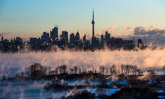 Mist rises from Lake Ontario in front of the Toronto skyline during extreme cold weather on Saturday