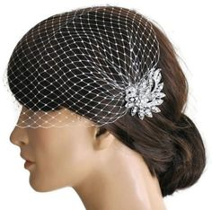 This set is made of two separate pieces!!! so you can remove the veil and wear only the comb after wedding ceremony.  The Rhinestone brooch