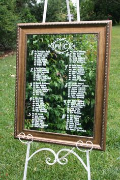 Bronze framed mirror seating chart with monogram detail