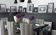 Photographs at the chair rail make this diningroom inviting