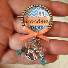 A personal favorite from my Etsy shop https://www.etsy.com/listing/197790075/grandma-to-be-pin-personalized-gift-baby