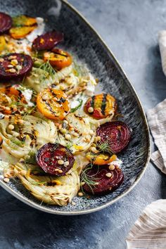 This hearty and flavorful grilled beet and fennel salad with sprouted lentils is accented with a schmear of plant-based orange and cumin scented yogurt. #beet #salad #vegan