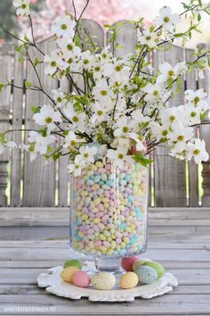 Easy Easter table centerpiece of jelly beans, dogwood and plum tree blossoms | homeiswheretheboatis.net #Easter #centerpiece #DIY