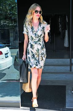 Kate Bosworth pairs neutral sandals with a palm printed dress