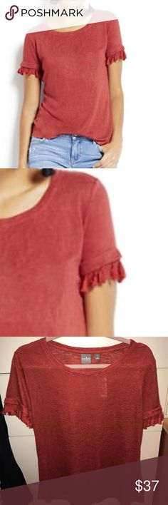NWT Tassel trim short sleeve boho chic t shirt Tassel accents add a boho-chic finishing touch to an essential warm-weather look: the scoopneck T-shirt.  OVERVIEW Scoopneck. Semi-sheer. Short sleeve with tassel trim. Color is a Burnt Orange  FIT & SIZING Hits at hip.  FABRIC & CARE 63% Rayon, 37% Polyester. Machine Wash. Imported. New York & Company Tops Tees - Short Sleeve