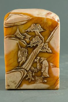 Chinese Shoushan stone carved seal, of rectangular sectioned with rounded top, featuring continuous village scenes. The stone of honey tone with white skin. Seven characters on seal face. H: 10 cm, L: 8 cm, 1884 grams.