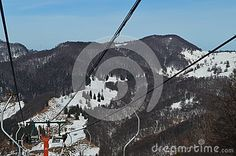 Cable cars and mountains view during winter season.