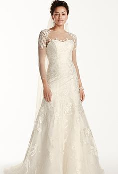 Brides: Oleg Cassini at David's Bridal. See more Oleg Cassini Gowns from David's BridalLace A-line gown with illusion neckline, three-quarter sleeves and floral lace epaulets.