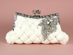 ON SALE Ivory Bridal Clutch, Wedding Clutch, Vintage Style Bridal Clutch with Large Crystal Vintage Style Brooch. $80.10, via Etsy.