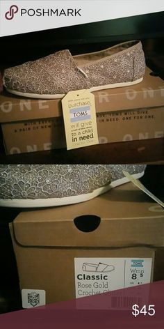 TOMS Classic Rose Gold Glitter Shoes Brand new Tom's gold slip on shoe.  Size 8.5.  Brand new in box. TOMS Shoes Flats & Loafers
