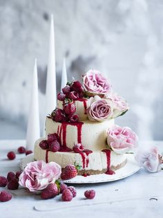 Three tiered white chocolate cheesecake strawberry roses floral