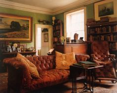 leather chesterfield, green wall, art