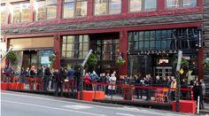 Seattle opens its first Downtown parklet by Gustafson Guthrie Nichol using Bison wood deck tiles and adjustable deck supports