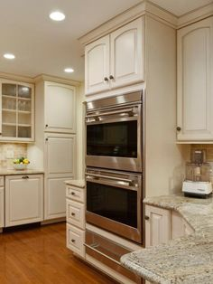 Open shelving with detailed valances, cabinets with plenty of drawer space, diagonal lazy Susan corners and updated appliances add that touch of simple elegance in this Country Kitchen.