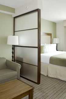 Glass privacy wall for bedroom entry - allows light in