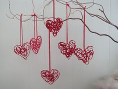Trace a heart shape on wax paper, then twirl yarn around and add glue to it. Let it dry!
