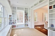 Vision: 1/2 home office, 1/2 playroom = a win win for Jonah and mommy!  Love the bookshelves around windows.