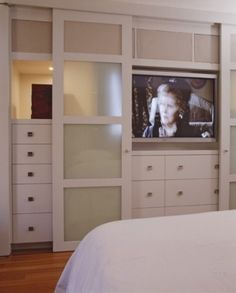 Hiding the tv with sliding closet doors, perfect for the bedroom