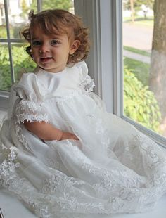 This dress is made from a designer that is committed to designing dresses of couture quality, unique designs, and LOTS of details. Watch your little one turn into a sweet angel instantly in this gorgeous gown. The taffeta bodice features short sleeves adorned with decorative lace and pretty sequins. This gown will truly be a memorable one for that special event.