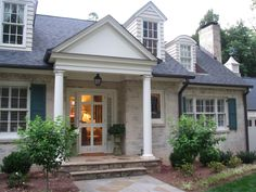 classic colonial cottage.  whitewashed brick + teal shutters + door