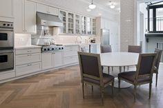 Light herringbone floors, tulip table, Louis chairs, white