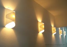 I've got a lot of lamp all around the house. I made these wall paper lamps in the entry. Once I had found the way to make the pattern, it ...