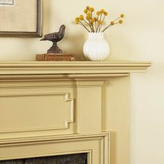 Ornate trim amplifies a mantel's warm, neutral hue. | Photo: David Prince