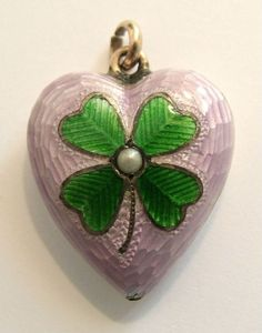 Edwardian puffy heart charm with lilac guilloche enamel and a four leaf clover motif. www.sandysvintagecharms.com