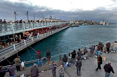 Lower level of Galata Bridge in Istanbul is lined with restaurants while above, fishermen cast their lines