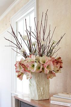 Massing bare branches in a giant bundle makes a striking display inside a circle of pink amaryllis, adding height and drama. Styling by Karin Lidbeck Brent, photography by Michael Partenio