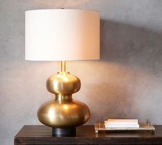 Isla Curvy Brass Lamp I like the books next to it. Good look