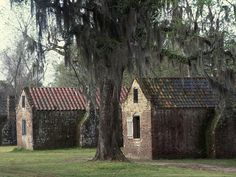 The slave houses at Boone Hall Plantation in Charleston. It is said to be one of America's most haunted and is said to be inhabited by the ghosts of the many mistreated slaves. The property had 225 slaves that worked and operated dangerous kilns for the local building industry beginning in 1817. According to legend, the numerous spirit sightings at the plantation have all occurred within 20 feet of the kiln, and a slave girl and slave boy are the most commonly spotted.