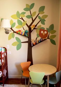 SO cute! Floating bookshelves mounted on wall on top of painted tree branches. Love it.