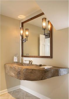 Love the stone basin top and basin!  If my bathroom allowed it, then I would have a double basin top - his and hers!