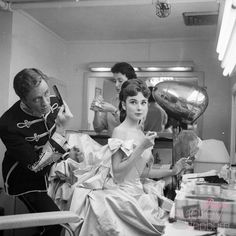 Behind the scenes photos of Audrey Hepburn and husband, Mel Ferrer, backstage before performing in a live television broadcast of Mayerling, February Audrey Hepburn Outfit, Audrey Hepburn Mode, Bella Thorne, Golden Age Of Hollywood, Old Hollywood, People Sitting, Scene Photo, Before Us, Beauty