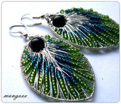 Peacock feathers by manngo.deviantart.com on @deviantART