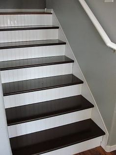 Basement stair idea - best one yet - high gloss stain on treads in a deep color with white wainscoting on the risers for beautiful contrast and high class look for less, just need to sand the treads to get the paint off....
