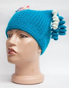 Turquoise hat with a flower and spirals от GGUA на Etsy, $20.00