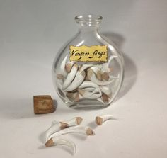 """Vampire Fangs - Great idea would be to find """"fangs"""" at Halloween time and put them i a jar, or whatever you can find that would resemble teeth."""