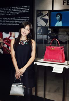 Actress Ha Ji-won with ther creation for the Fendi Seoul Peekaboo project. The bag is inspired by her favorite song 'You are the Universe'.