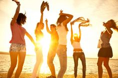 Photo about Happy young teens dancing at the beach on beautiful summer sunset. Image of hands, beach, shore - 30032497