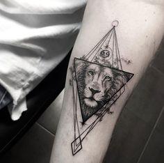 Geometric lion tattoo by Sara Reichardt