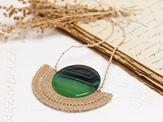 Crochet Lace Necklace Pendant in Ecru with Emerald Green Agate Ancient Sun Symbol, The Source of Life via Etsy You've searched for Jewelry! Lace Necklace, Crochet Necklace, Pendant Necklace, Crochet Jewellery, Fiber Art Jewelry, Jewelry Art, Bijoux Wire Wrap, Fabric Jewelry, Crochet Accessories