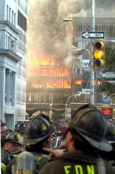 New York City firefighters stand back and watch as the remaining floors of the World Trade Center's South Tower burns uncontrollably. (Photo: Steven E. We Will Never Forget, Lest We Forget, Tsunami, World Trade Center Attack, Remembering September 11th, Westerns, We Remember, Egypt, New York City