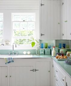 The couple updated their 1930s kitchen cabinets by adding beadboard doors plus new knobs and pulls.